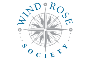 A logo for the Wind Rose giving society that contains a compass rose.